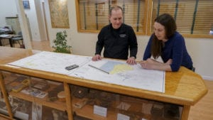 Owner Steve Salsury looks over plans with Vice President Tara Hartson