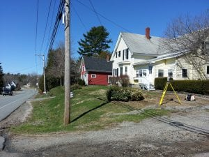 photo of residential neighborhood with surveying equipment setup