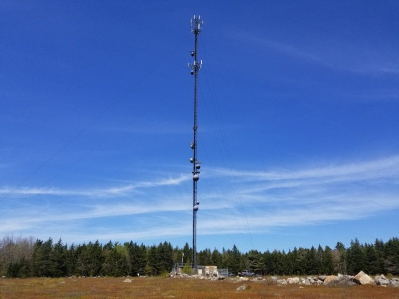 photo of a communications tower in a field