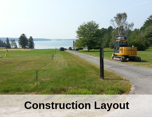 photo of staked land and the words construction layout