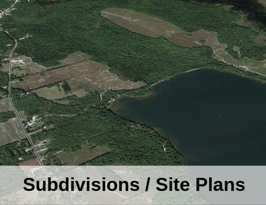aerial photo of lake with words subdivisions / site plan