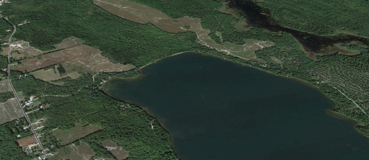 aerial photo of lake and land to be divided
