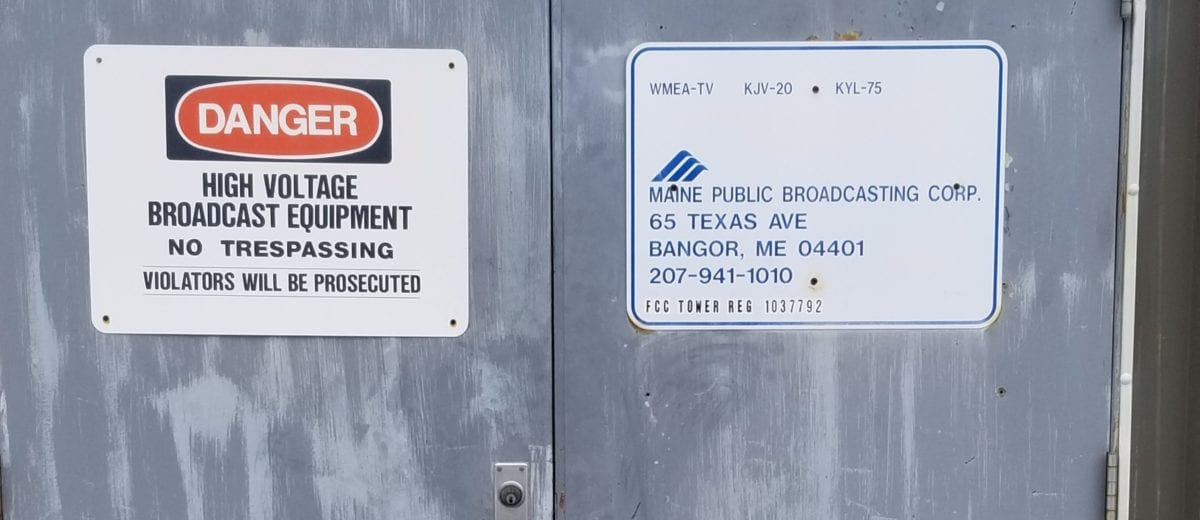 photo of signs on door danger high voltage broadcast equipment no trespassing