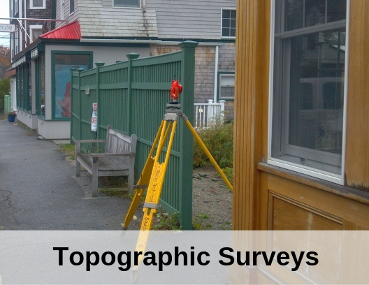 photo of surveying equipment in town with words topographic surveys
